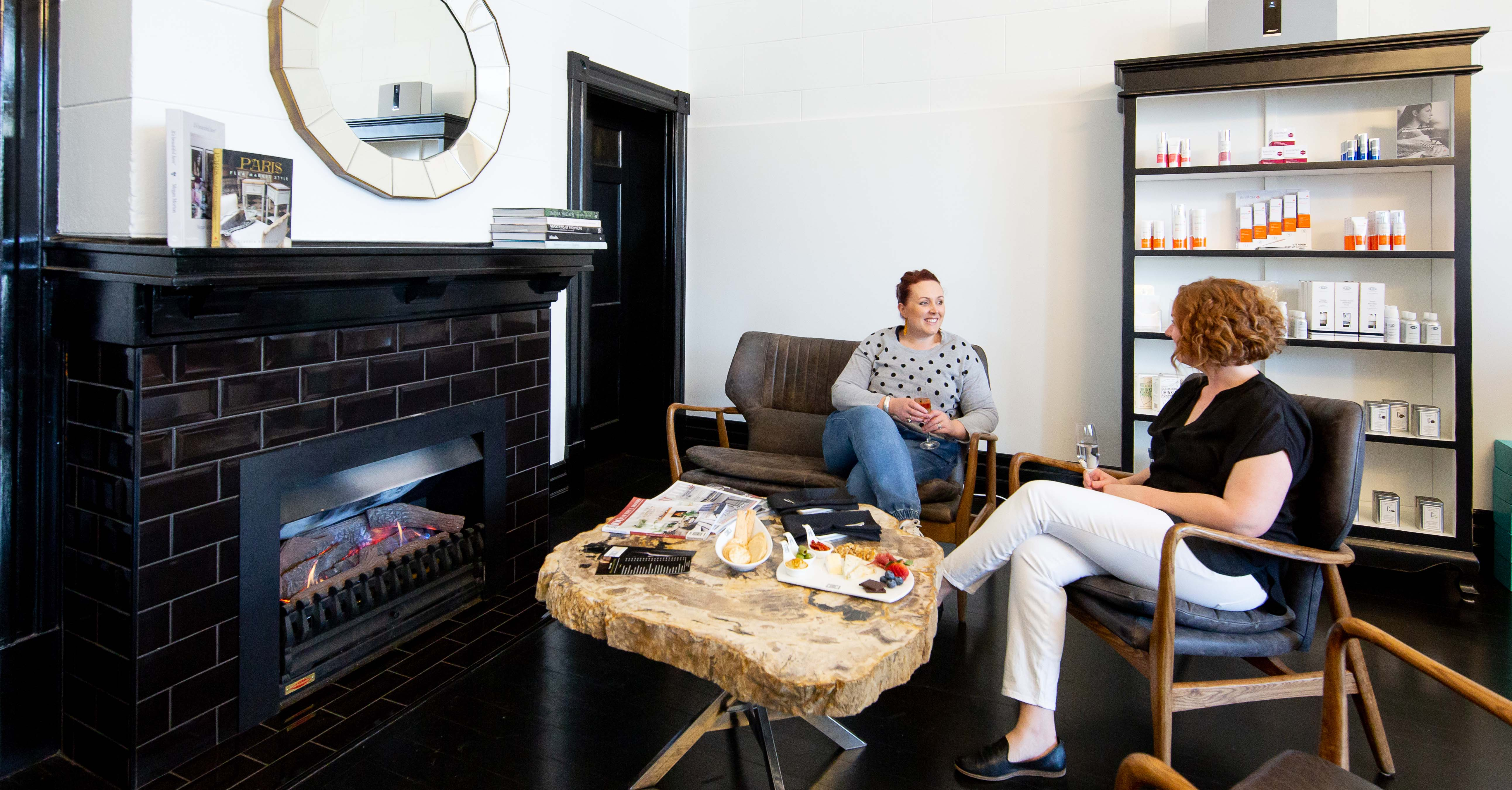 Relax by the fire at Circa 1929 Spa in Wagga Wagga
