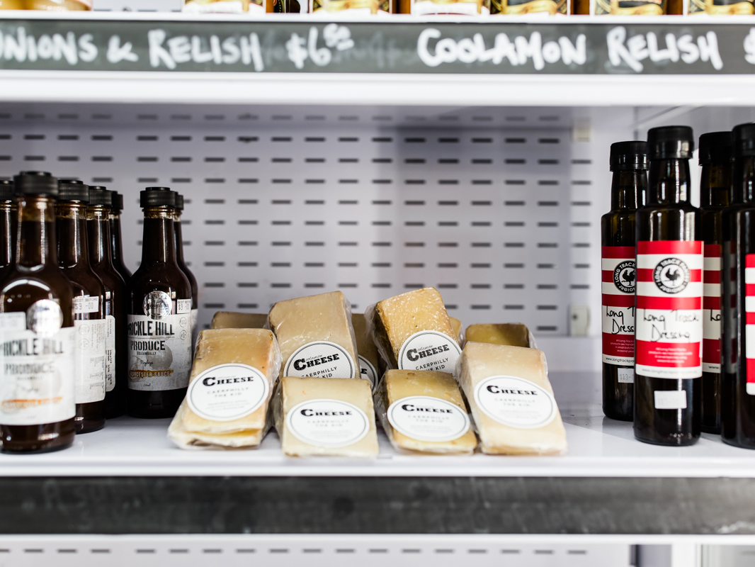 Packets of Coolamon Cheese and other grocery items in a fridge self serve for customers